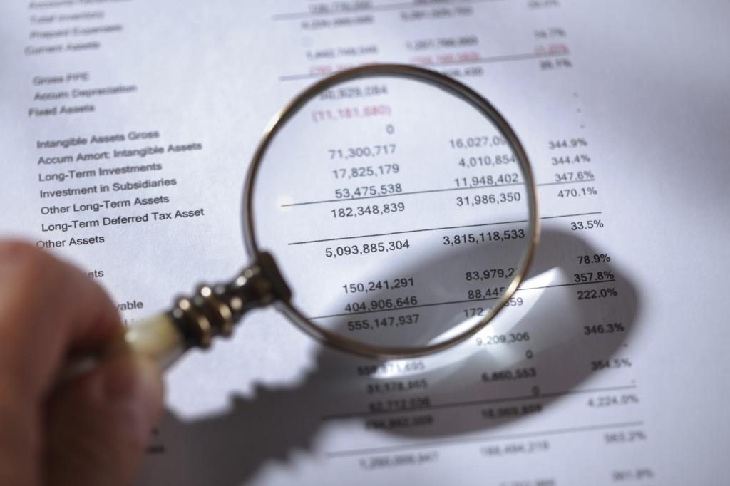 Magnifying glass on financial reports